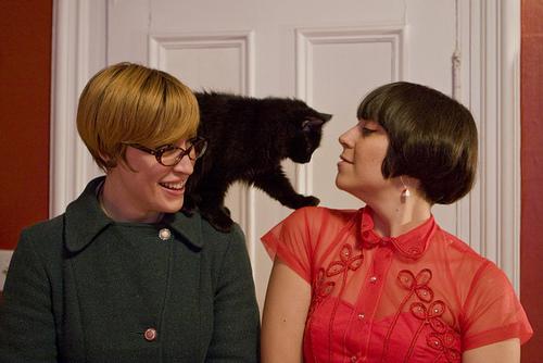 Political style blogger, à la garçonnière, greeting her cat