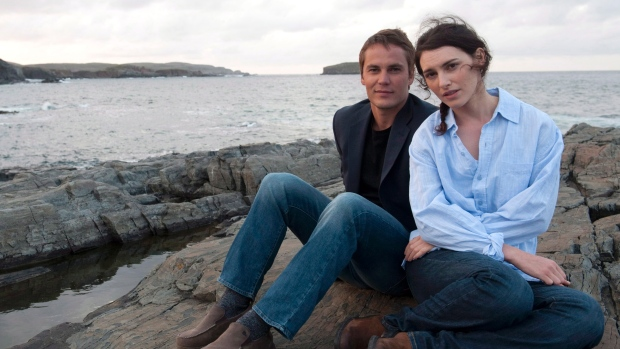Liane Balaban and Taylor Kitsch in The Grand Seduction.