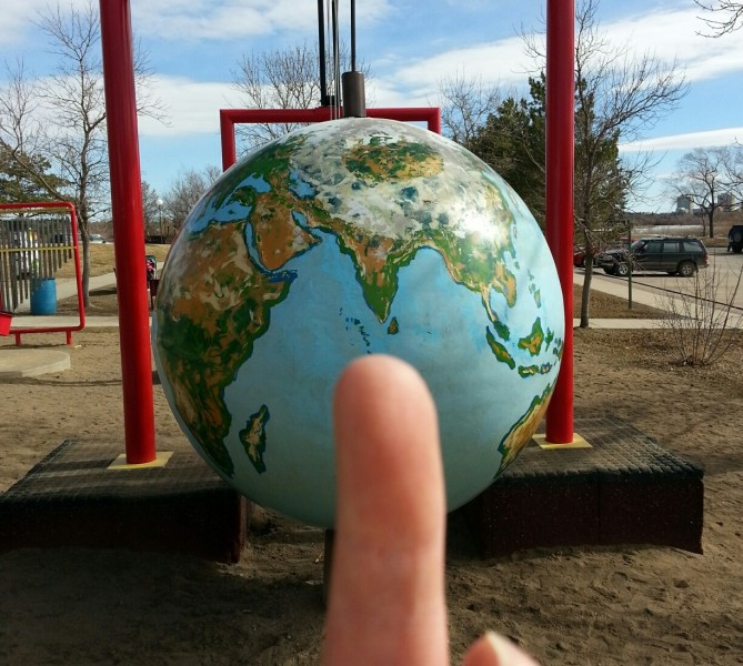DRILLING FOR DOLLARS Giant middle finger extended to Earth during press conference